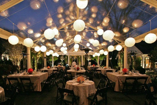 outdoor-wedding-reception-in-clear-tent-with-globe-lights.jpg